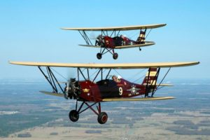 bi-planes_flying_in_formation_at_the_air_zoo_in_michigan